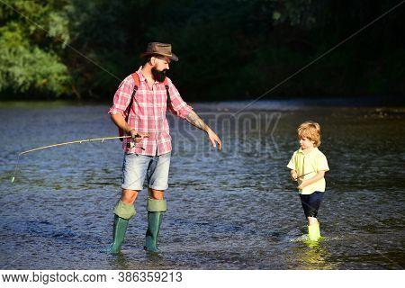 Portrait Of Two Generation Men Fishing. Little Boy Fishing With Father. Generations Ages: Father And
