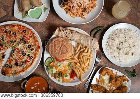 Traditional Indian Cuisine. Top View Of Indian Dishes. View Of Indian Food Or Flat Table.