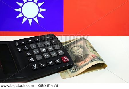 Green Ten Yuan Banknote Of China, Obsolete Money Series 1936 And Calculator On The White Floor With