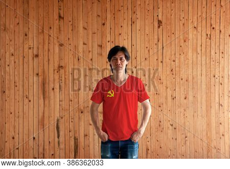 Man Wearing Chinese Communist Party Flag Color Shirt And Standing With Two Hands In Pant Pockets On