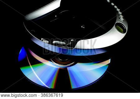 Cd Player And Cd Isolated Against A Black Background
