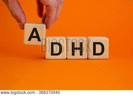 Concept Words 'adhd, Attention Deficit Hyperactivity Disorder' On Cubes On A Beautiful Orange Backgr