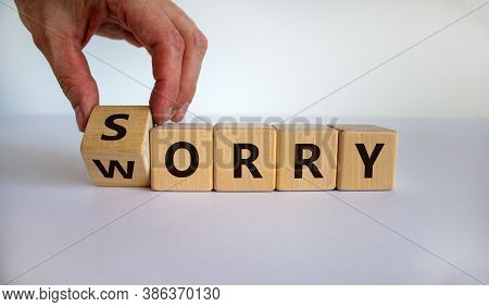Sorry To Worry. Hand Turns A Cube And Changes The Word 'worry' To 'sorry'. Beautiful White Backgroun