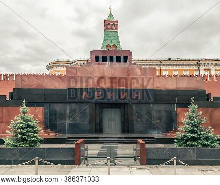 Lenin Mausoleum On Red Square In Moscow. The Inscription In Russian Is Lenin.