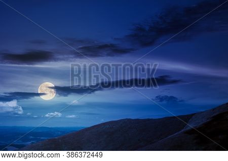 Hills And Meadows Under The Blue Sky At Night. Hills And Meadows Under The Blue Sky At Night. Mounta