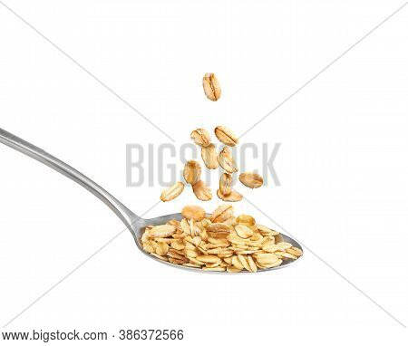 Flying Oatmeal In A Spoon On A White Background