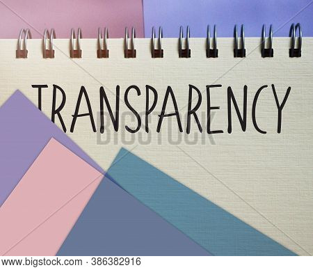 Transparency Word Written On Copybook Page . Transparency Text On Table, Concept.