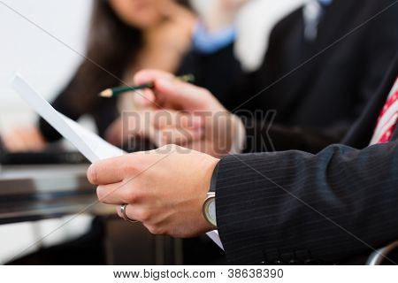 Business people sitting in a meeting or workshop in an office