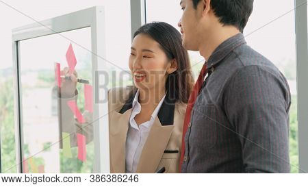 Business People Work On Project Planning Board In Office And Having Conversation With Coworker Frien