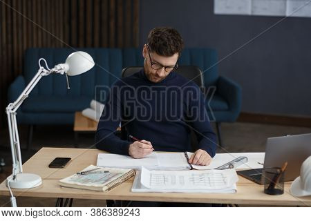 Architect Working In Office With Blueprints.engineer Inspect Architectural Plan, Sketching A Constru