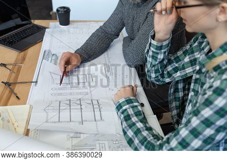 Interior Designers Team Working In Office With Blueprints And Architect Equipment, Sketching, Negoti