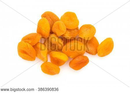 Preserved fruit. Group of dried sulfurized apricots  isolated on white background. High angle view