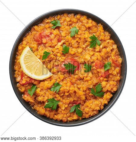 Red Lentils Dal In Black Bowl Isolated On White Background. Lentils Tomato Dhal Is Indian Cuisine Di