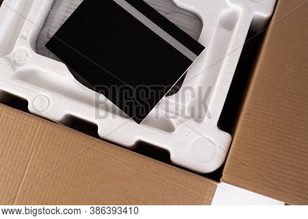 Open Cardboard With Styrofoam Material. Isolated On White Background. Transportation Of Fragile Carg