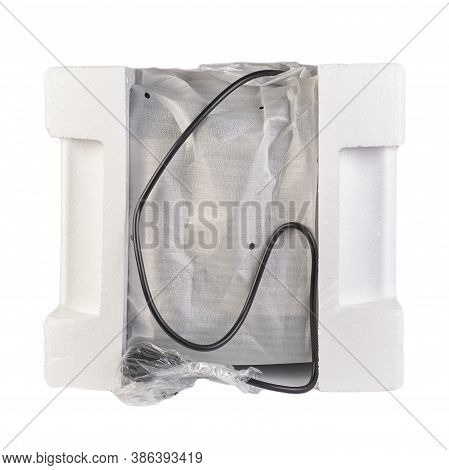 Packaging Of Goods With Expanded Polystyrene For Safe Transportation Of Goods. Isolated Over White B