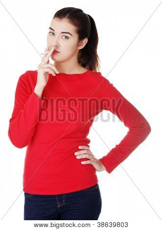 Young woman smoking electronic cigarette (ecigarette), isolated on white