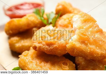 Tasty Fried Chicken Nuggets On Light Table, Closeup