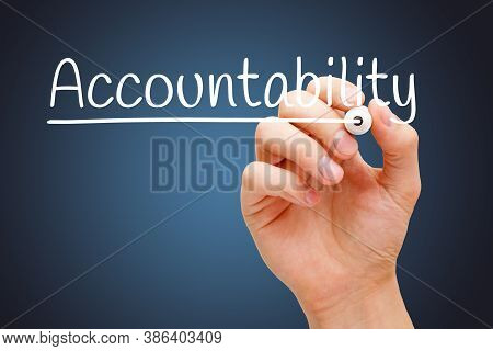 Hand Writing The Word Accountability With White Marker On Transparent Wipe Board Over Dark Blue Back