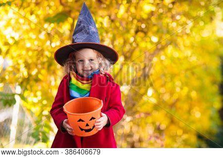 Kids Trick Or Treat On Halloween Night.