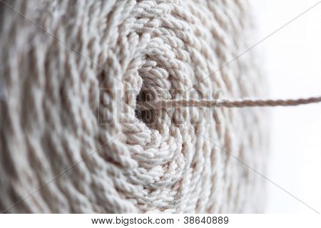 Reel or spool of cotton thread being pulled out