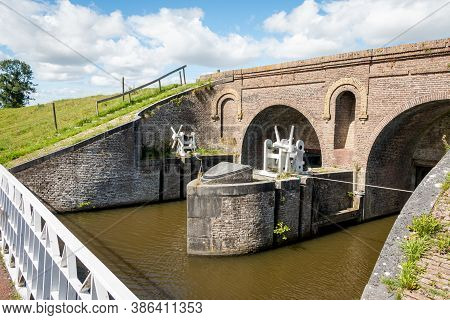 Old Medieval Sluice Called The Aduarderzijlen First Built In 1400 Near Aduarderzijl, In The Province