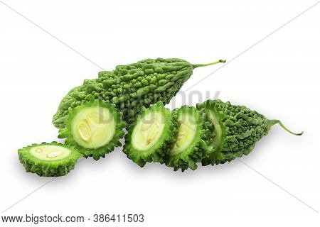 Organic Green Bitter Gourd On White Isolated Background With Clipping Path. Raw Bitter Gourd Or Bitt