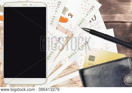 10 British Pounds Bills And Smartphone With Purse And Credit Card. E-payments Or E-commerce Concept.