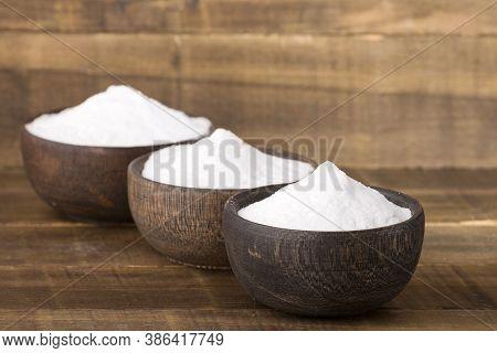 Stevia Powder, Natural Sweetener. Stevia Rebaudiana - Wooden Background