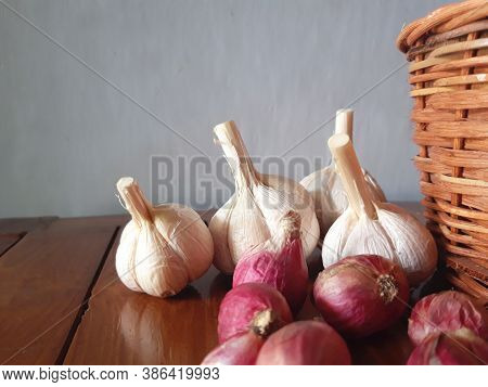 Ripe And Raw Organic Onion And Garlic On Wooden Background, Alternative Medicine, Organic Cleaners.