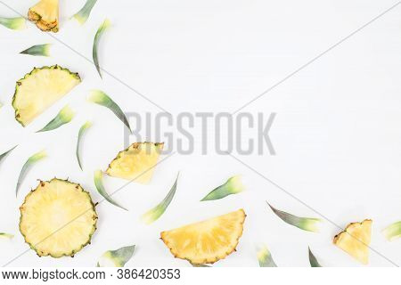 Sliced Pineapple With Green Pineapple Leaves Isolated On White Background With Copy Space For Your T