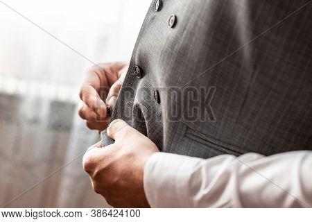 Groom Fastens A Button On His Vest At The Groom's Morning Gatherings.the Groom Fastens The Button. W