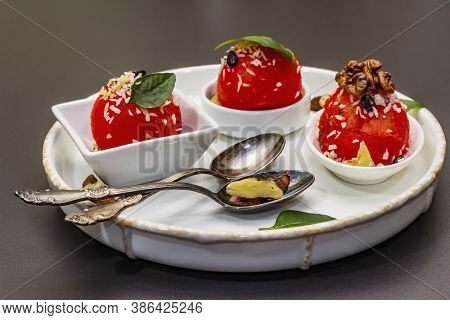 Watermelon Ice Cream Or Sorbet With Coconut Flakes, Walnuts And Fresh Basil Leaves