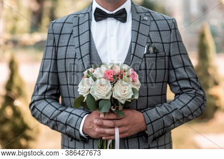 The Groom Adjusts His Jacket, Groom In A Jacket, Groom In Gray Tuxedo And Bowtie Correct His Buttons