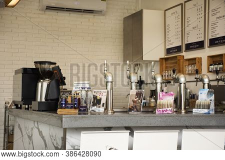 Interior Decoration Furniture Of Cafe Coffee Shop With Staff Barista Brew Make Coffee Serve For Cust