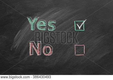 Two Voting Checkboxes With Lettering Yes And No On Blackboard. Check Mark Near Yes. Your Choice Conc