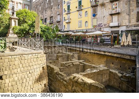 Naples, Italy - September 8, 2016: Ruins Of The Greek Walls Of Naples At Piazza Bellini, Naples, Ita