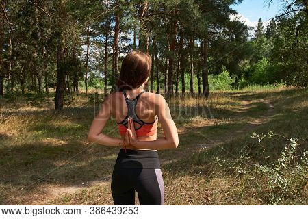 Beautiful Young Woman In Sportive Top And Leggings Practicing Yoga In The Morning On The Nature. Hea