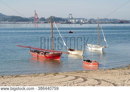 Villagarcia De Arosa, Spain: September 12, 2020: Traditional Sailboats Anchored On The Beach. Old Fi