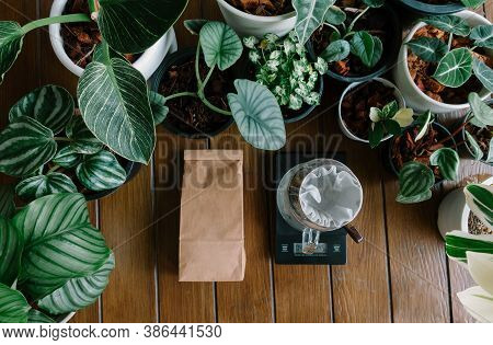 Top View Of Hand Drip Coffee,barista Tools, Digital Scale And Brown Paper Bag Package Of Craft Coffe