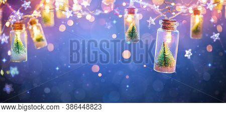 Abstract Christmas Card With Defocused Vintage Effects - String Light With Trees In Glass Jars Decor