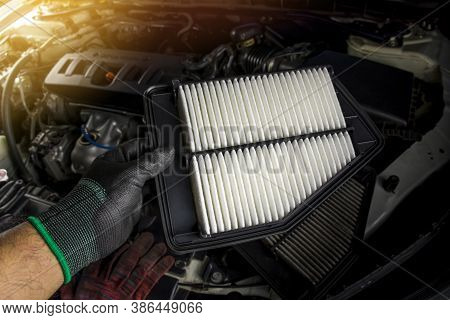 Car Air Filter Is In The Hands Of A Mechanic For Replacing The Dirty Air Filter