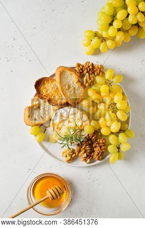 Plate With Roast Camembert And Slice Of Bread And Brunch Of Green Grape, Copy Space, Top View, Verti