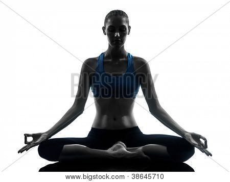 one caucasian woman exercising yoga meditating in silhouette studio isolated on white background