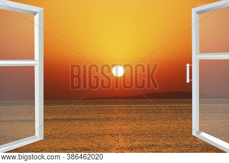 Window Open Into Sunset Over The Sea. View Of Sunrise Over Sea From Open Window. Sunrise And Seascap