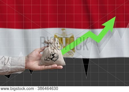 The Concept Of Economic Growth In Arab Republic Of Egypt. Hand Holds A Bag With Money And An Upward