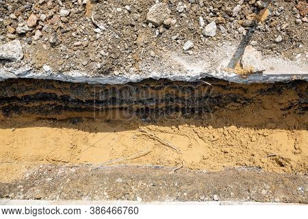 Digging Road Before Install Pipe Water. Excavation Water Drainage At Construction Site. Digging Road