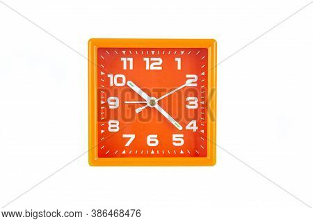 Orange Square Alarm Clock Isolated On White Background. Clock, Time, Do Not Oversleep At School Or W
