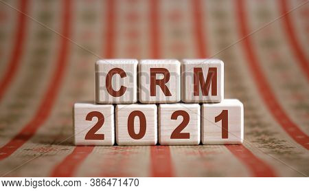 Crm 2021 Text On Wooden Cubes On A Monochrome Background With Reflection.