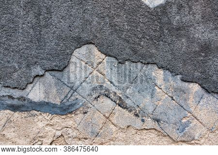 Old Decrepit Dirty Plaster Wall Background With Cracked Structure. Old Black Gray Grey Mortar Wall W