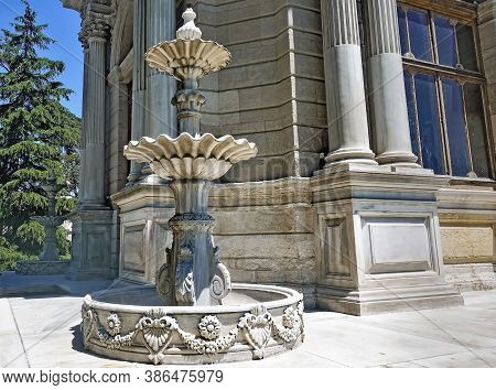 Marble Three-tier Graceful Fountain In The Garden Of Dolmabahce Palace. Bowls Of The Fountain In The